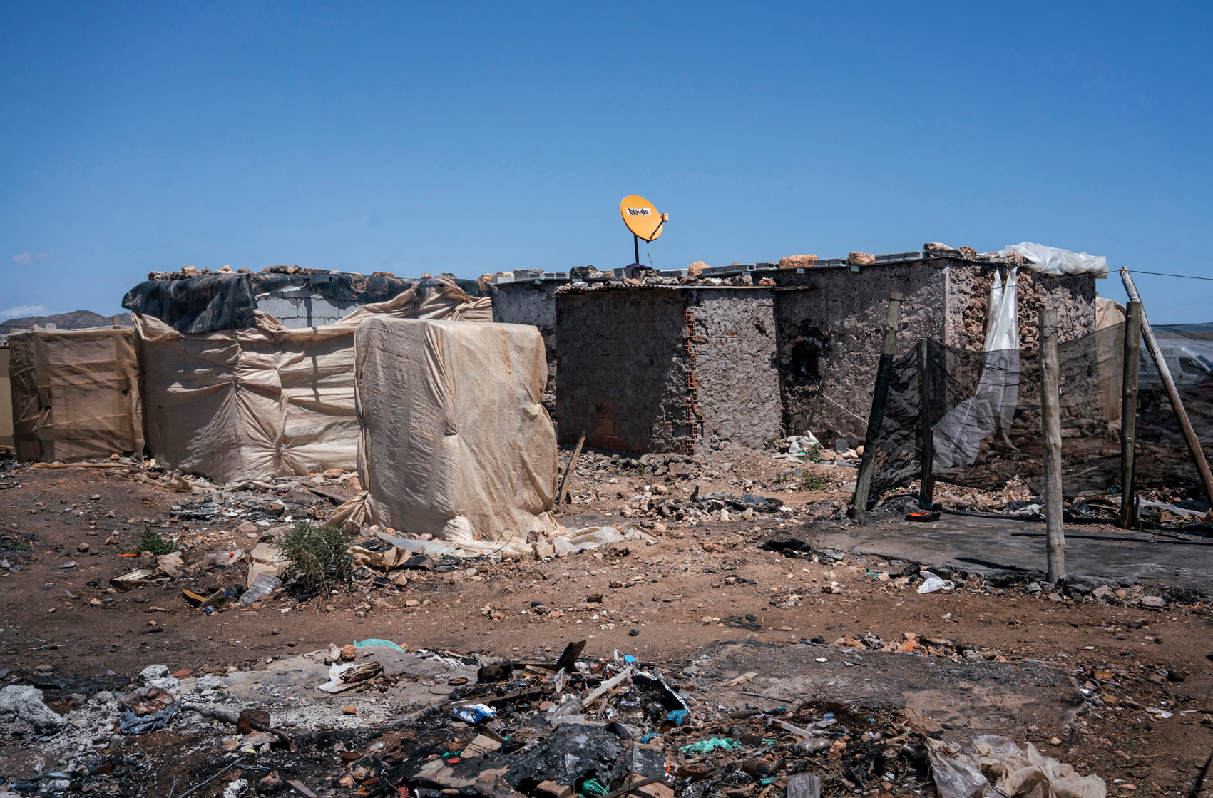 Self-constructed shacks in the migrant workers' ghetto, Spain.