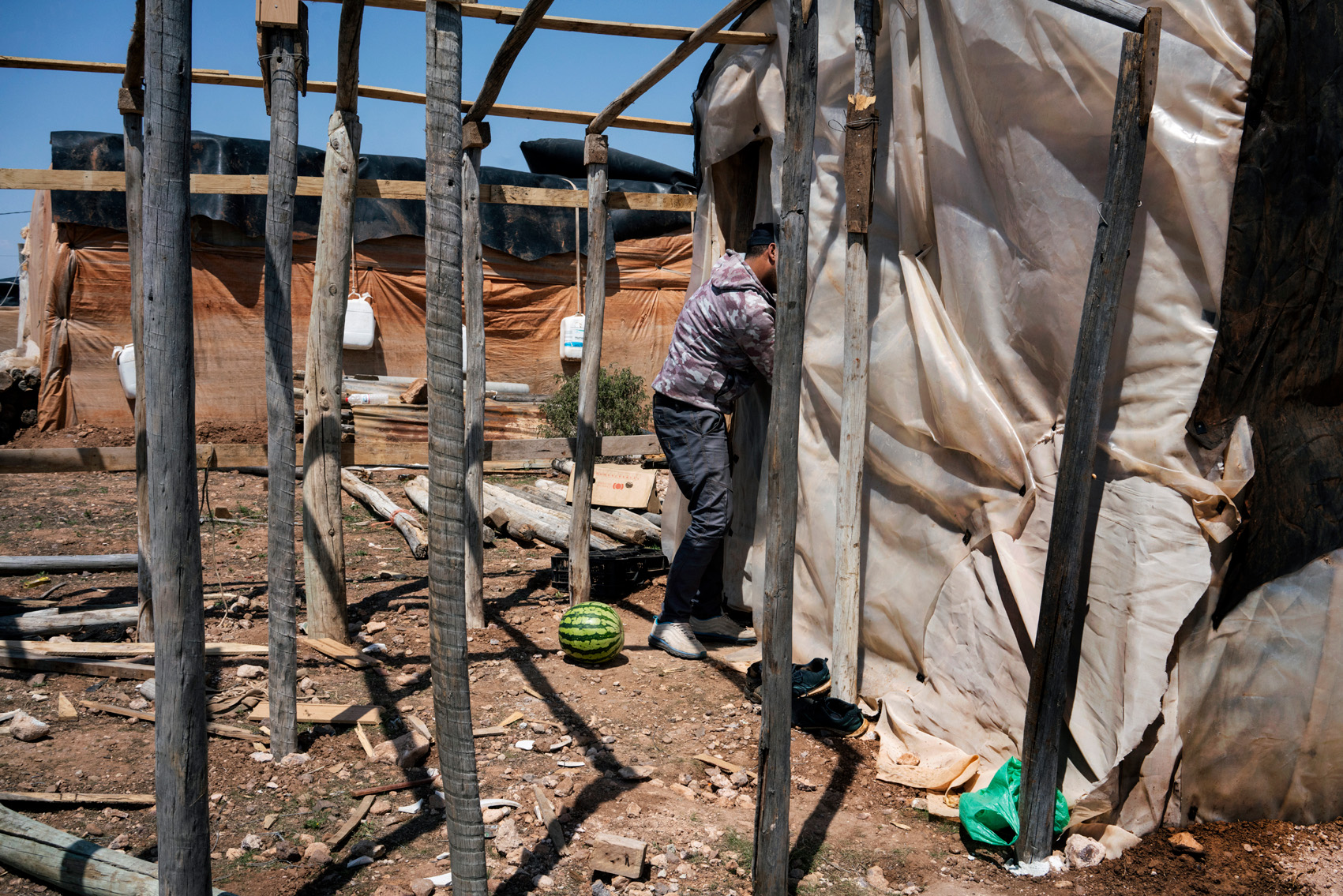A Moroccan migrant worker in a ghetto of self-constructed plastic shacks, Spain.