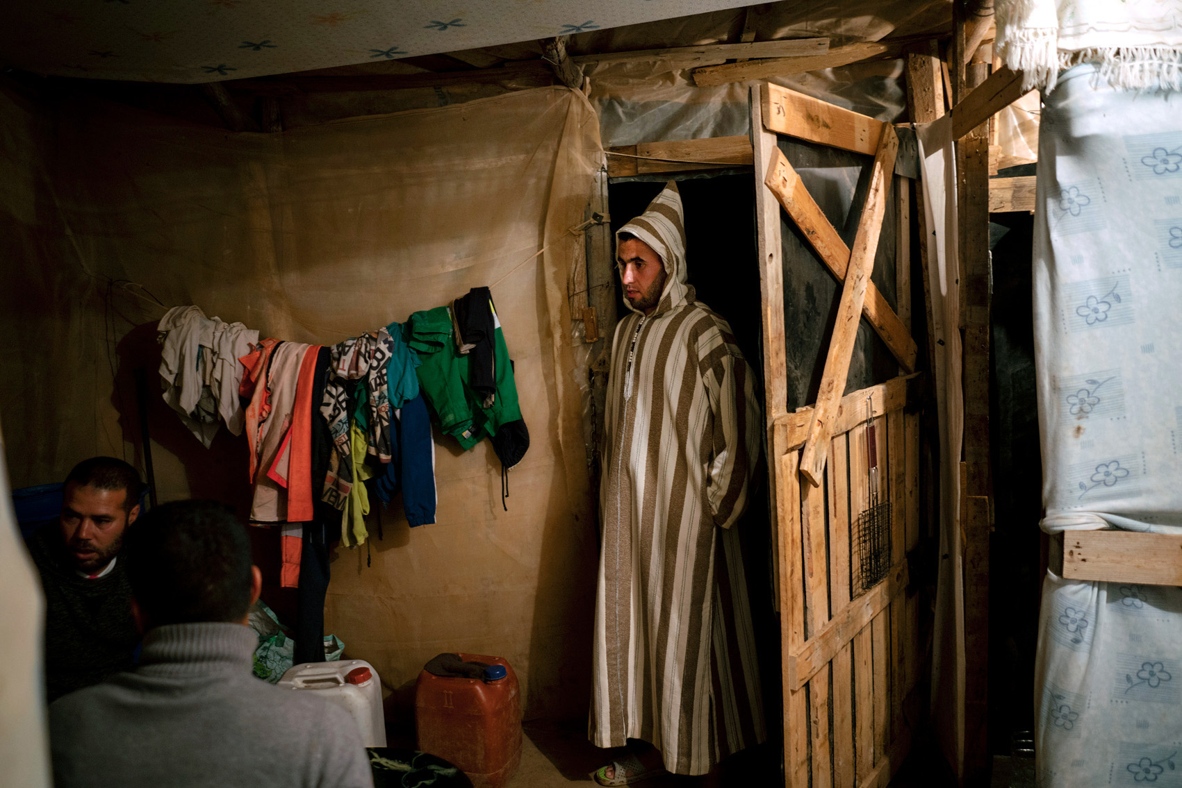 Moroccan migrant workers sharing a self-constructed house made of plastic sheets in the workers' ghetto, Spain.