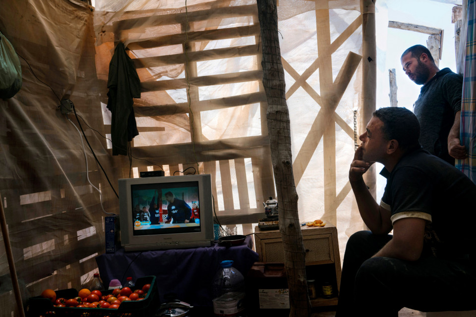 Moroccan migrant workers living in a ghetto of self-constructed houses made of plastic sheeting, Spain.