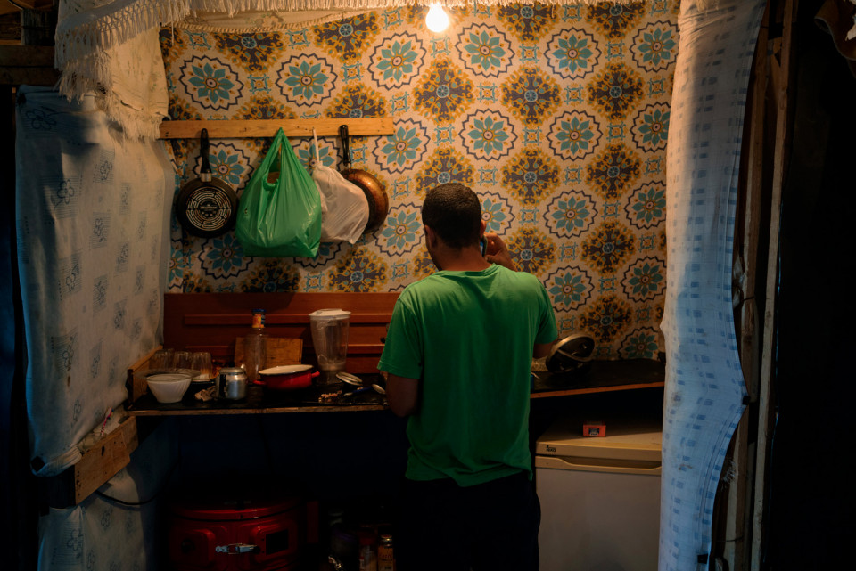 Ahmedi from Morocco is preparing dinner in his kitchen, Spain.