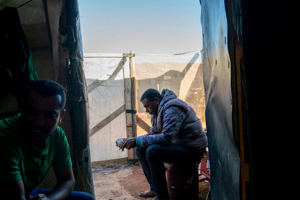Rachid, a Moroccan migrant worker, in a self-constructed house of plastic, in a ghetto of African migrants, spain.