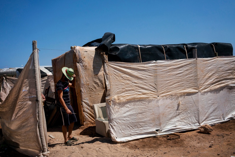 A Moroccan migrant worker living in a ghetto of self-constructed plastic shacks, Spain.